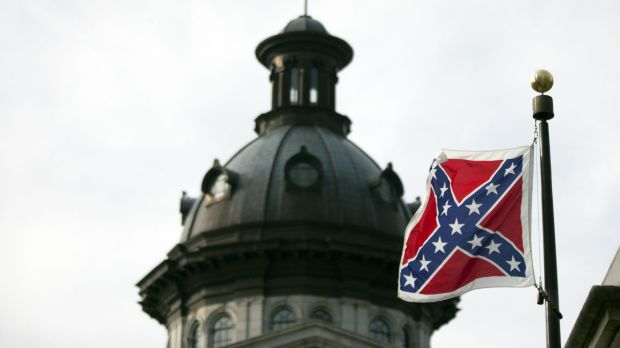The Confederate battle flag flutters in the breeze in front of the South Carolina state house.