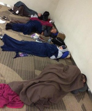 Travellers were forced to sleep at Ngurah Rai International Airport as flights out were cancelled.