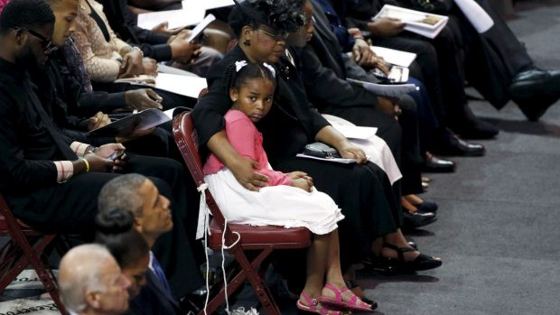 Malana Pinckney, daughter of the Reverend Clementa Pinckney, is hugged by her mother Jennifer at her father's funeral in ...