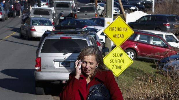 A woman mourns while speaking on the phone near Sandy Hook Elementary School, after the December 2012 shooting there ...