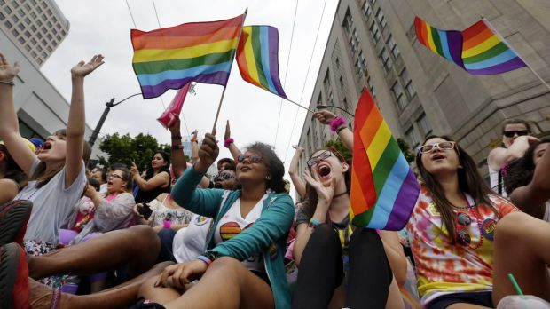Hundreds of thousands of people packed gay pride events from New York City to Seattle, San Francisco to Chicago in June ...