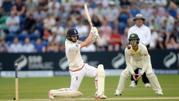 Tail wagging ... Mark Wood lashes the ball to the boundary, helping England reach an overall lead of 411.