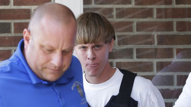 Dylann Roof, right, was allowed to buy a gun used to slaughter nine churchgoers in South Carolina in 2015.