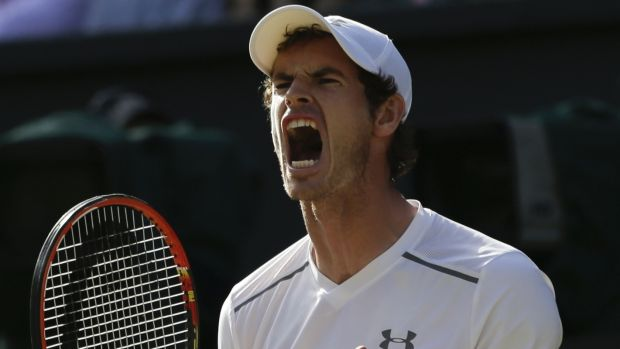 Overpowered ... Andy Murray celebrates winning a point against Roger Federer in their semi-final.
