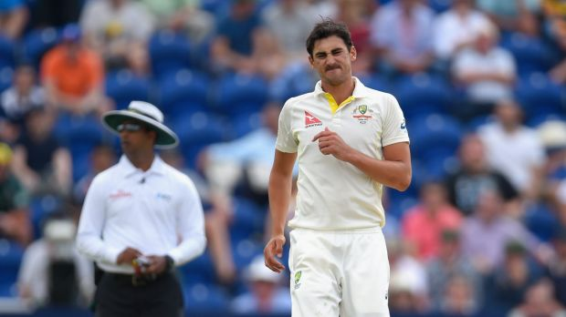 Grimace: Mitchell Starc hobbles back to his mark on day three in Cardiff.