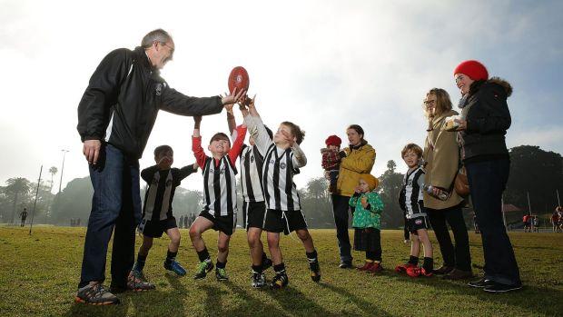 Volunteer Jason Howard helping out with Auskick kids
