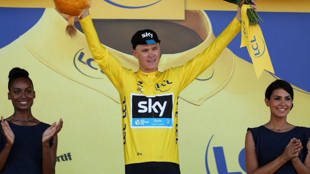 Chris Froome of Great Britain and Team Sky celebrates as he retains the yellow jersey following stage eight of the 2015 ...
