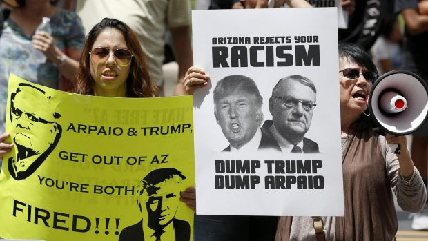 In Arizona, Trump aligned himself with controversial police official Joe Arpaio.