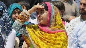 Nobel Peace Prize laureate Malala Yousafzai shades her eyes against the sun at a school for Syrian refugee girls, built ...