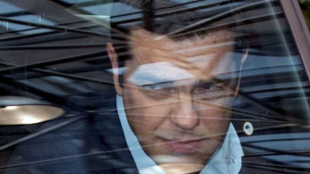 Greek Prime Minister Alexis Tsipras arrives in his car at the eurozone leaders' summit in Brussels.