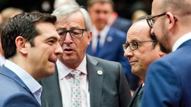 Greek Prime Minister Alexis Tsipras, far left, speaks with (from left) European Commission President Jean-Claude ...
