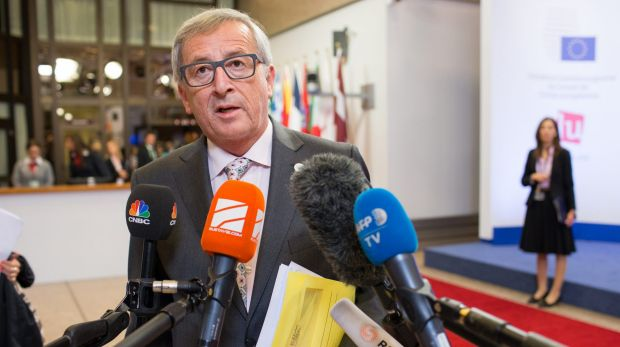 Jean-Claude Juncker, president of the European Commission, speaks with journalists following all-night Greece bailout ...