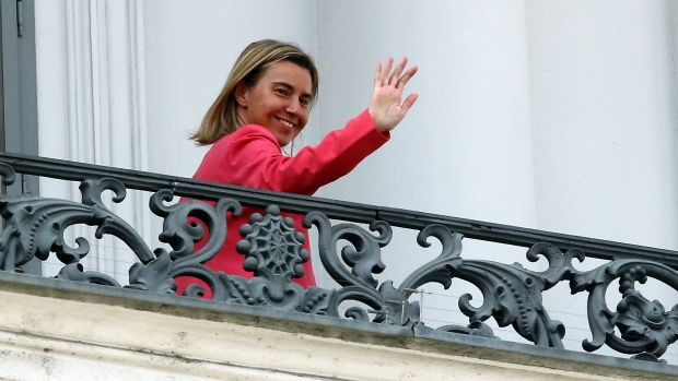 European Union High Representative Federica Mogherini waves on Monday from a balcony of the Palais Coburg where ...