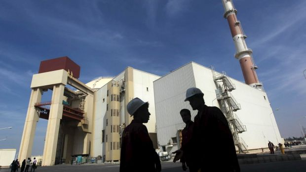 Iranian workers stand in front of the Bushehr nuclear power plant, about 1200 km south of Tehran.