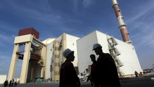 Iranian workers chat in front of the Bushehr nuclear power plant, about 1200 kilometres south of Tehran.