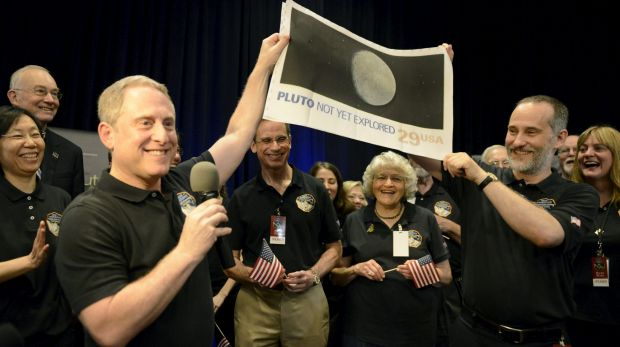 NASA principal investigator for the New Horizons mission Alan Stern (left) and co-investigator Will Grundy (right) hold ...