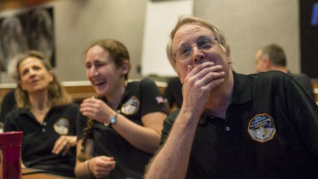 Members of the New Horizons science team react to seeing the spacecraft's last and sharpest image of Pluto.