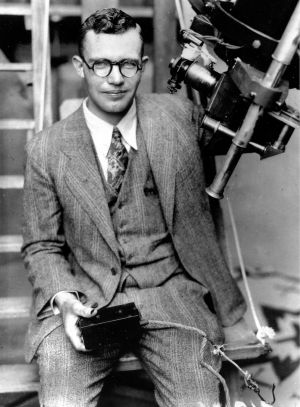 Clyde Tombaugh with the telescope through which he discovered Pluto, at the Lowell Observatory on Observatory Hill in ...