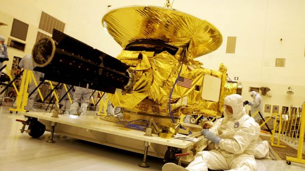 Technicians work on the payload for the New Horizons mission to Pluto on Friday, November 4, 2005, at the Kennedy Space ...
