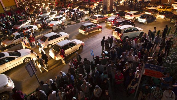 Iranians celebrate in the street following the signing of the deal that is expected to improve conditions in the country.