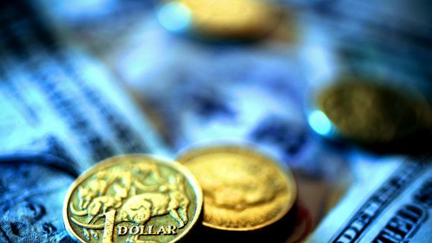 Under pressure: The Australian dollar fell by more than one per cent on Tuesday night amid tumultuous global markets.