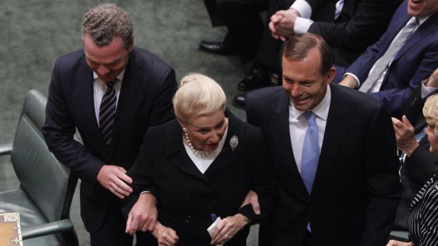 Bronwyn Bishop is dragged to the Speaker's chair by Prime Minister Tony Abbott and Christopher Pyne after the 2013 election.