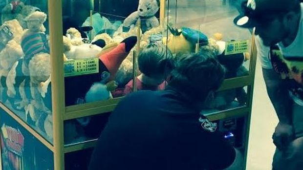 The toddler stuck in the toy machine at a Cairns shopping centre.