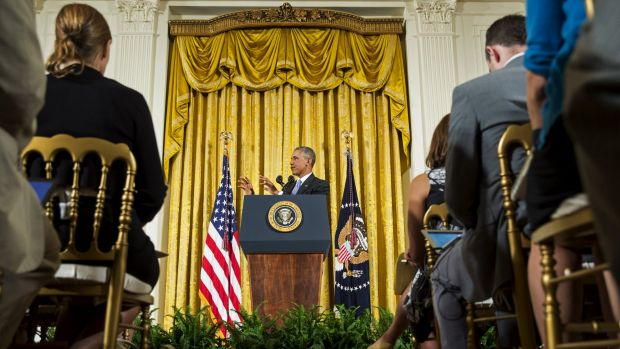 Barack Obama and the press corps in the East Room of the White House.