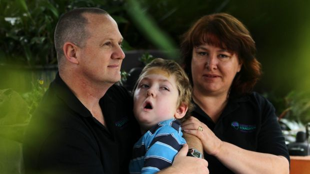 Michael and Jo-Ann Morris with Samuel, aged 7. Samuel was left disabled after a near drowning in the family pool in 2006 ...