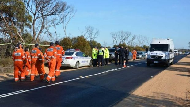 Police and emergency services at the Karoonda Highway near Wynarka in July.