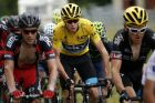 Team Sky rider Chris Froome of Britain (C), race leader's yellow jersey, rides during the 195-km (121.16 miles) 12th ...