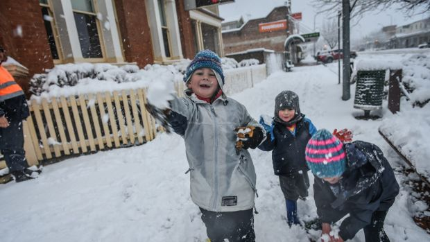 Fun in the snow as local children stay home from school and play in the Biggest snow fall in around 40 yrs as locals ...
