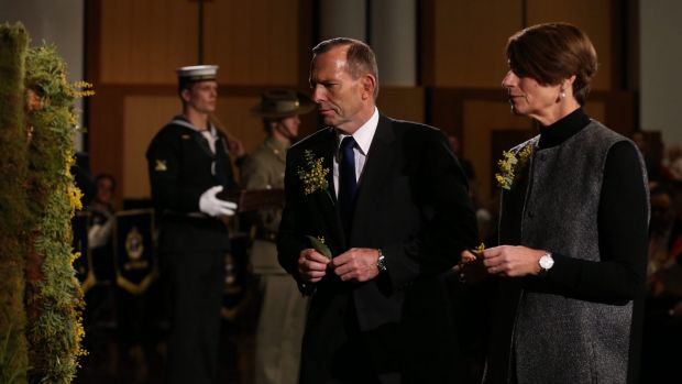 Prime Minister Tony Abbott and his wife Margie place a floral tribute on the wreath at the National Memorial Service for ...