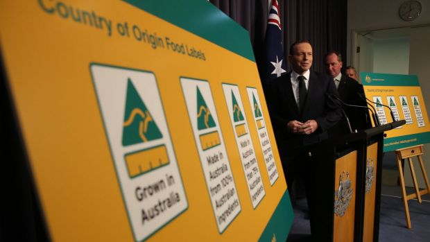 Prime Minister Tony Abbott, Agriculture Minister Barnaby Joyce and Industry Minister Ian Macfarlane announce the new labels.