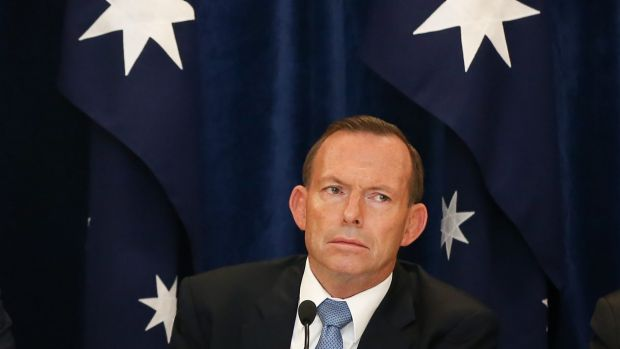 """Prime Minister Tony Abbott controversially replied """"nope, nope, nope"""" when asked in May if Australia would do more to ..."""