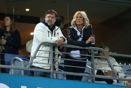 Russell Crowe and Julie Burgess have long denied speculation they are dating.