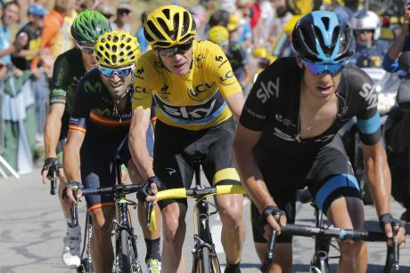 In front: Britain's Chris Froome, wearing the overall leader's yellow jersey, and Australia's Richie Porte, climb during ...