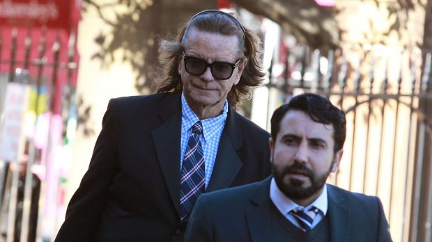 Charles Waterstreet (left) arrives at the murder trial of Roger Rogerson and Glen McNamara in July.