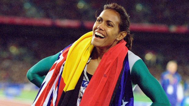 Cathy Freeman celebrates winning gold at the Sydney Olympics in 2000.