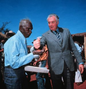 Then-Prime Minister Gough Whitlam pours sand into the hand of Vincent Lingiari in 1975.
