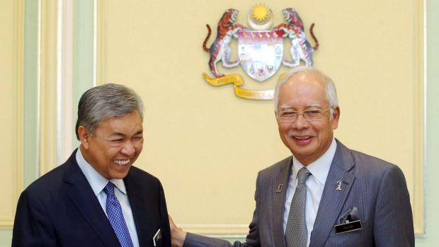 Malaysian Prime Minister Najib Razak (right) announces the appointment of new Deputy Prime Minister Ahmad Zahid Hamidi ...