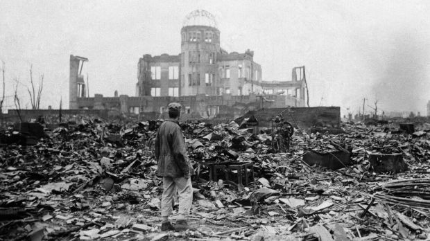 An Allied correspondent stands in the rubble of a building that once was a movie theatre in Hiroshima, on Sepember 8, ...