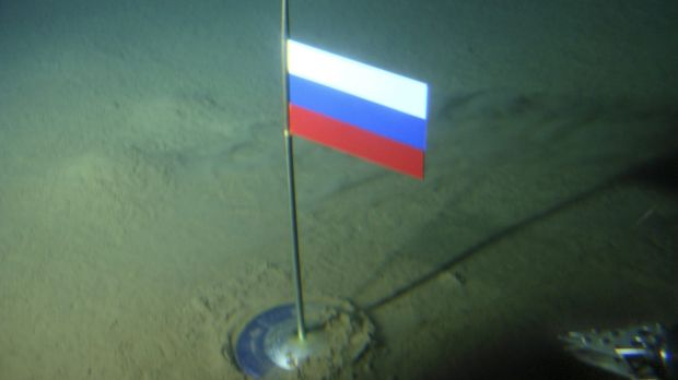 A titanium capsule with the Russian flag is seen seconds after it was planted by the Mir-1 mini submarine on the Arctic ...
