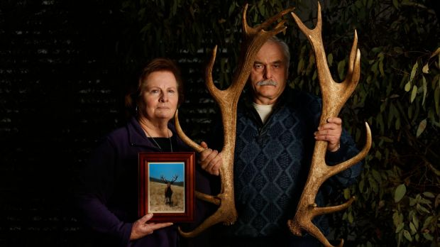 Narelle and Manfred Wagner show off Karl's antlers from last year and hold a newly developed photograph of the deer.