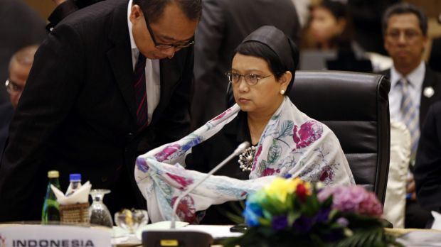 Indonesia's Foreign Minister Retno Marsudi listens to a delegation memeber in Kuala Lumpur.