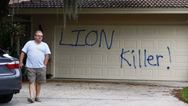 Walter Zalisko, a private investigator for the Palmer family, outside the home following a vandalism attack.