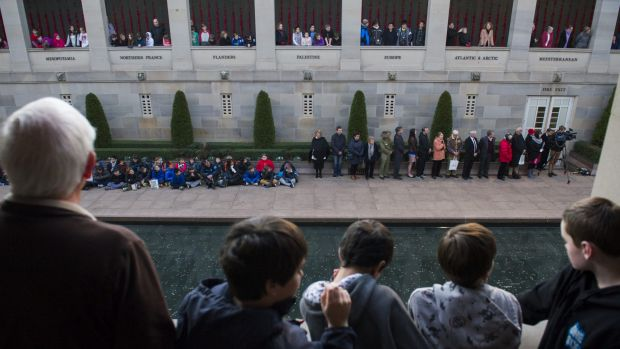 Visitors gather at a Last Post ceremony at the War Memorial last year.