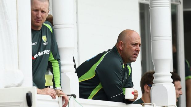 Low point: Lehmann surveys the carnage from the balcony at Trent Bridge.