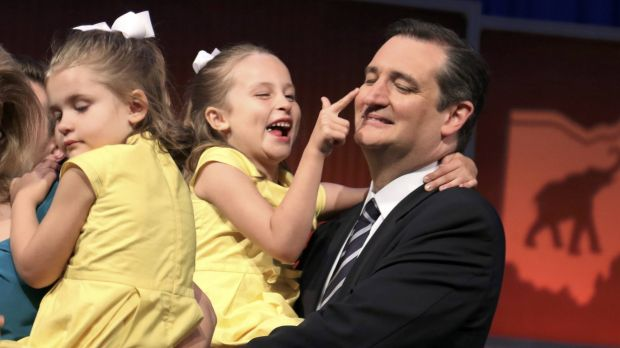 Candidate Ted Cruz hugs his daughters onstage at the end of the debate.