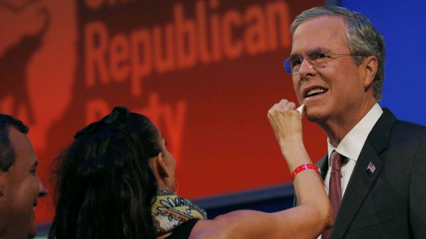 Jeb Bush gets a touchup from a makeup artist before the debate.